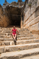 Young man at theatre in Myra ancient city of Antalya in Turkey.