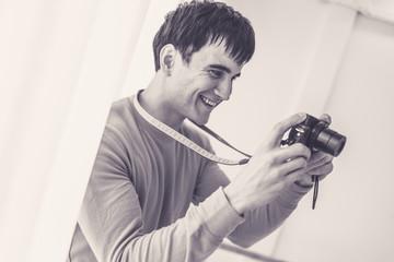smart handsome caucasian white man hand hold camera for hobby white background