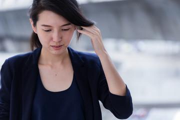 beautiful asian smart woman in navy color suit portrait outdoor location