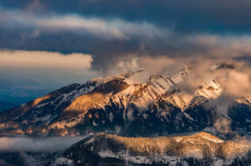 panorama of snowy Tatra Mountains in clouds, poland