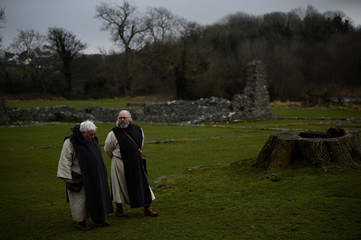Actors dressed as monks attend the re-enactment of the first landing of Saint Patrick in Ireland at Inch Abbey in Downpatrick