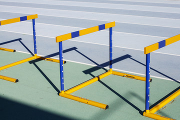 Yellow blue jumping hurdles on running track