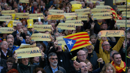 People hold banners during a demonstration held by pro-independence associations in Barcelona