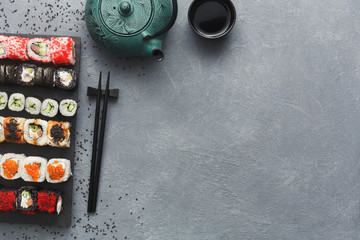 Top view set of sushi maki and rolls on grey table