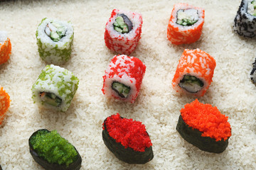 Closeup of sushi rolls and gunkan on rice