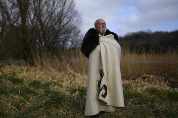 Philip Campbell who plays Dicu the Dalfiatach Chieftan poses for a photograph during the re-enactment of the first landing of Saint Patrick in Ireland at Inch Abbey in Downpatrick