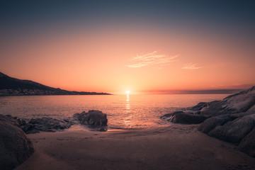 Sunset on sandy Algajola beach in Corsica