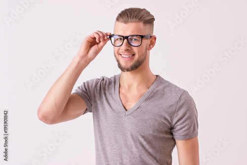 cf35e96f93d Charismatic and stylish bearded hipster man in glasses looking to camera.  Young student