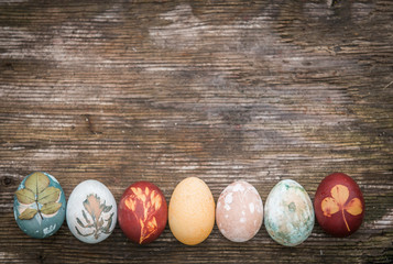 Easter eggs decoration with eggs over rustic wooden background, copy space