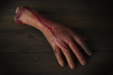 severed hand in the blood