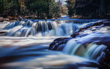 Beautiful Waterfall Time Lapse. Colorful Flowing Water.