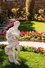 An ancient figure in a public garden.Giardini Capri, Italy