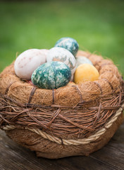 Close up of colorful Easter eggs in basket