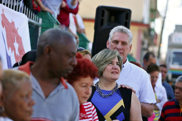 Cuba's First Vice-President Miguel Diaz-Canel stands in line with his wife Lis Cuesta and local residents before casting his vote during an election of candidates for the national and provincial assemblies, in Santa Clara