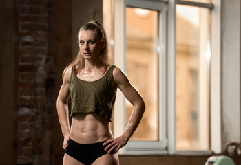 Portrait of beautiful fit healthy woman in fitness center