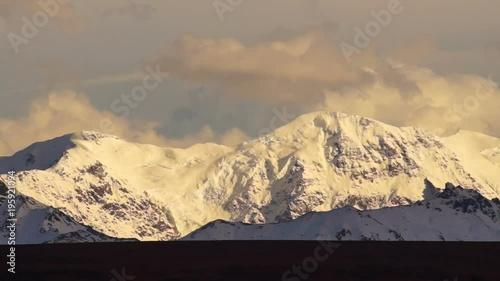 Wall mural Clouds Pass High Mountain Ridge Glacier Alaska Wilderness