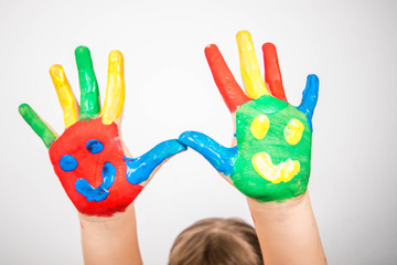 children hands in colorful paint with smiles