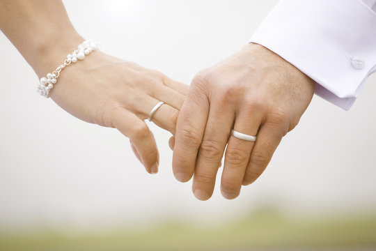 Wedding rings hands bridal couple