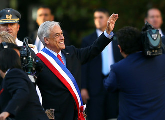 Chile's  President Sebastian Pinera waves to people at La Moneda Presidential Palace in Santiago
