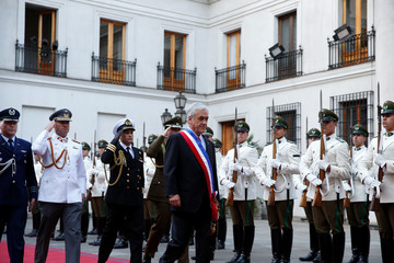 Chile's President Sebastian Pinera inspects honour guard at La Moneda Presidential Palace in Santiago