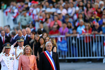 Chile's President Sebastian Pinera, accompanied by his wife and first Lady Cecilia Morel, arrives at La Moneda Presidential Palace in Santiago, Chile