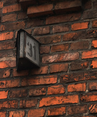 31 The house number on the old brick wall. Thirty-one.