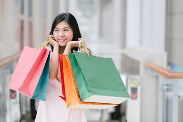 Happy Asian woman enjoy shopping
