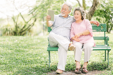 Happy senior Asian couple the using tablet