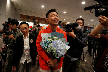 Democratic Alliance for the Betterment and Progress of Hong Kong candidate Vincent Cheng celebrates after winning in Hong Kong