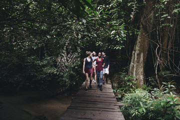 Group of friends walking through a forest
