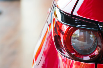 Car tail light red color for customers. Using wallpaper or background for transport and automotive image.