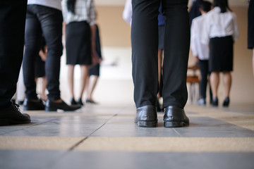 Legs of business man and woman waiting in a row for job interview
