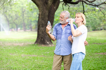 Senior couple standing drinking water