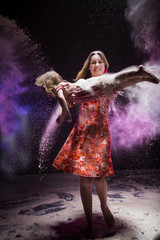 Young mother and small daughter during photoshoot with flour