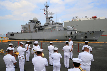 Philippine Navy band perform as they welcome the French Navy ship Vendemiaire (F734), a Floreal-classlight surveillance frigate of the French Marine Nationale upon arrival for a five-days goodwill visit at a port in Metro Manila
