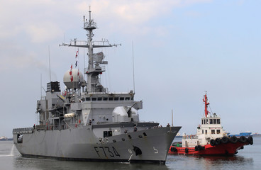 A tugboat escorts French Navy ship Vendemiaire (F734), a Floreal-classlight surveillance frigate of the French Marine Nationale upon arrival for a five-days goodwill visit at a port in Metro Manila