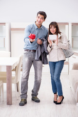 Young couple saving money for new furniture