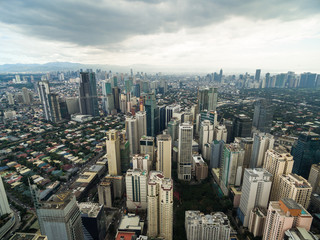 Manila Cityscape, Makati City with Business Buildings and Cloudy Sky. Philippines. Skyscrapers in Background.