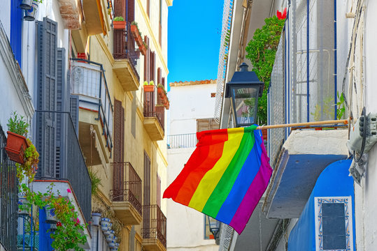 City views and gay flags on buildinds in a small town in the out