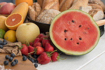 Several fruits and bread on the table in the kitchen