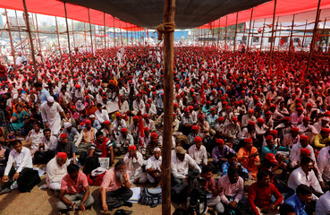 Farmers listen to a speaker at a rally organised by All India Kisan Sabha (AIKS) in Mumbai