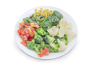 Various frozen vegetables on the white dish closeup
