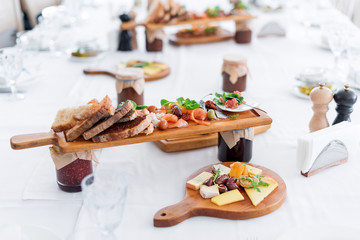 Delicious food. Different meals for the guests on the table in restaurant. Healthy mediterranean cuisine.