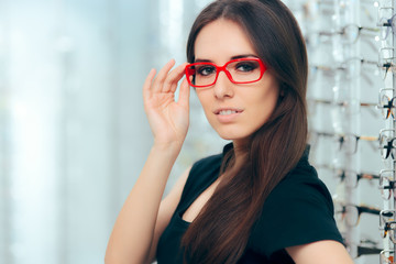 Woman Wearing Eyeglasses in Optical Store