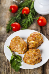 Delicious cutlets, tomatoes and parsley