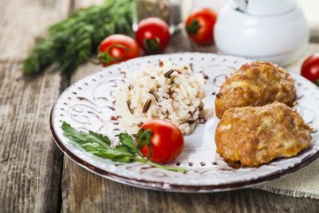 Delicious cutlets, rice, tomatoes and parsley