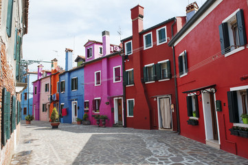Burano island, Venice, Italy - a street with colorful houses