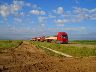 Trucks transport the concrete beam