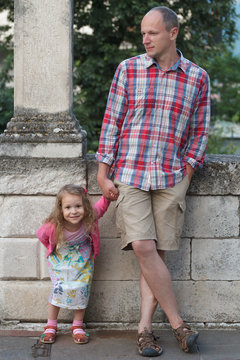 Father with his daughter individually full length street down town portrait