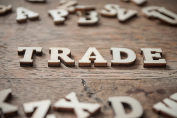 concept wooden letters on wooden table background - Trade